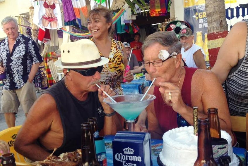 Herman Savoie, left, shown sharing a drink with his late partner Bruce Allen in Progreso, Mexico this year. - Facebook