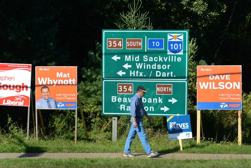 Election signs dot an intersection ahead of the 2013 provincial election in Lower Sackville. - Ingrid Bulmer / File