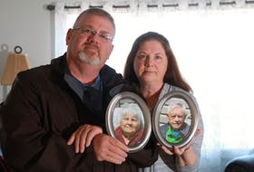 Brother and sister, Shawn Newhook and Barb DeJong, hold photographs of their parents, Josephine Frances and Murdoch James. - Eric Wynne