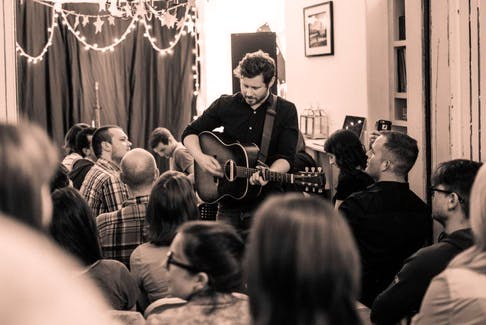 Side Door co-founder Dan Mangan performing at a show arranged via the Halifax-based home-concert organizer.