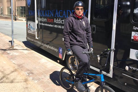 Mathew Fee Jr. stands in front of the motor home he will be living in as he bikes across the country. - Josh Young
