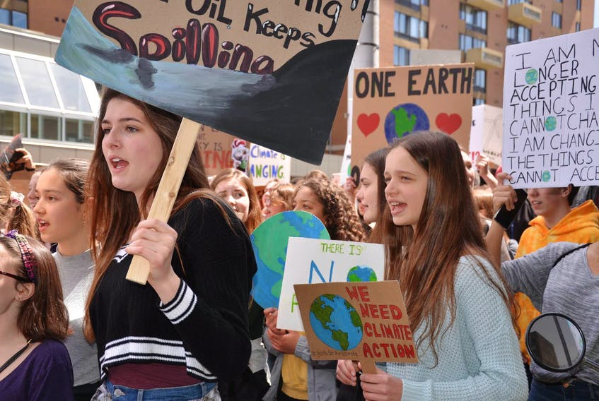 Hundreds of high school students marched in downtown Halifax on Friday afternoon to protest government inaction on climate change. - Francis Campbell