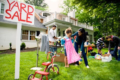 If your yard isn't visible from the street or you live in a sleepy part of town, consider asking a friend who resides on a well-travelled street if you can hold your sale in her yard instead. - Getty Images