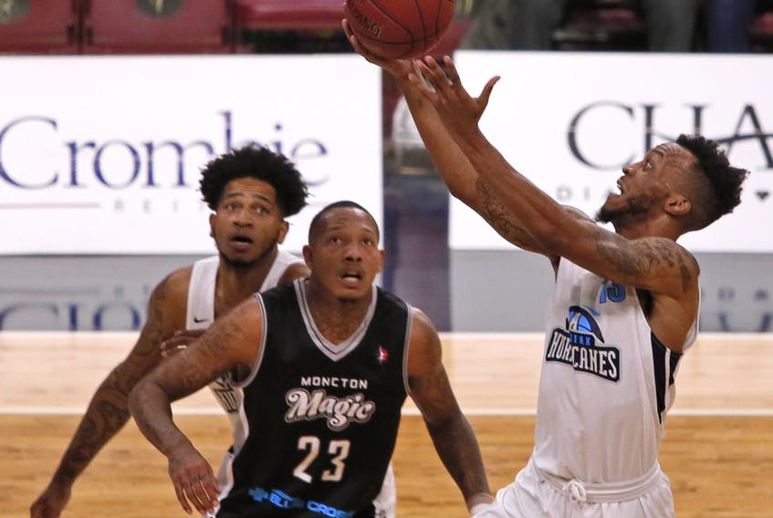 Halifax Hurricanes' Joel Kindred lays up a shot as Billy White of the Moncton Magic looks on during an NBL Canada game earlier this season at Scotiabank Centre. White, a former Hurricane, and the Magic face the St. John's Edge in the NBL Canada championship. - File