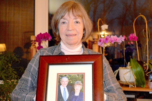Norma Silverstein holds a photograph of her parents at her home in Albert Bridge in March. Silverstein's father, John Ferguson, died of septic shock caused by bedsores. - Cape Breton Post