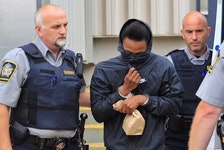 Rae'heem Downey is led out of the Dartmouth courthouse last August after his arraignment on a charge of murder in the June 18 shooting of Jamie Lee Bishop in Eastern Passage. - Tim Krochak