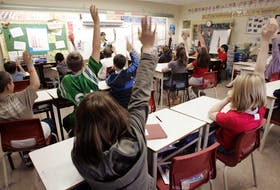 Students put up their hands in a Grade 6 class at Fairview Heights Elementary in Halifax. The March 2018 report of the commission on inclusive education called for an independent Nova Scotia Institute for Inclusive Education, but that call has gone unheeded. - Eric Wynne