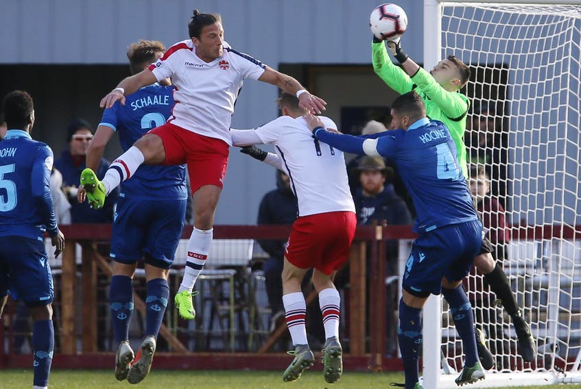 HFX Wanderers FC keeper Christian Oxner punches away a Vaughan Azzurri corner kick during the second leg of their Canadian Championship matchup Wednesday in Halifax. - Tim Krochak