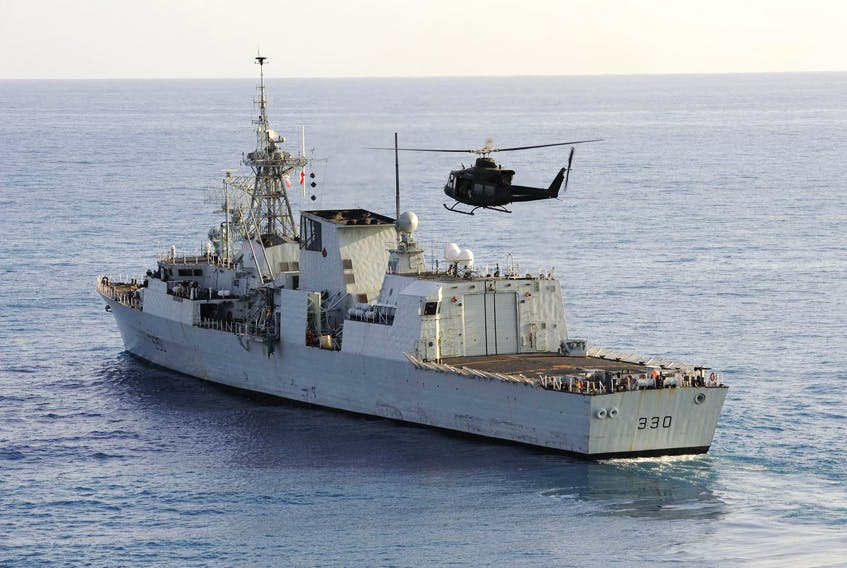 A CH-146 Griffon helicopter lands on the HMCS Halifax near Port-au-Prince, Haiti, in February 2010. - Cpl. Pierre Thériault