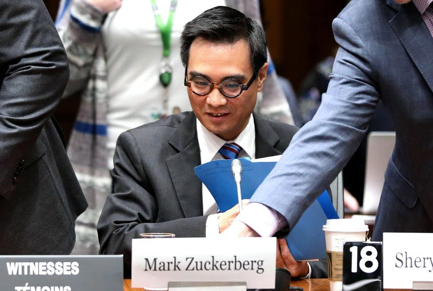 Kevin Chan, global director and head of public policy of Facebook Canada, looks on as a name plate for Facebook CEO Mark Zuckerberg is placed in front of him after Zuckerberg failed to appear at the International Grand Committee on Big Data, Privacy and Democracy meeting in Ottawa Tuesday.