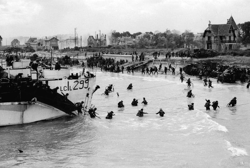 Troops of the 9th Canadian Infantry Brigade land on Juno Beach at Bernières-sur-Mer, Normandy, France, on June 6, 1944.