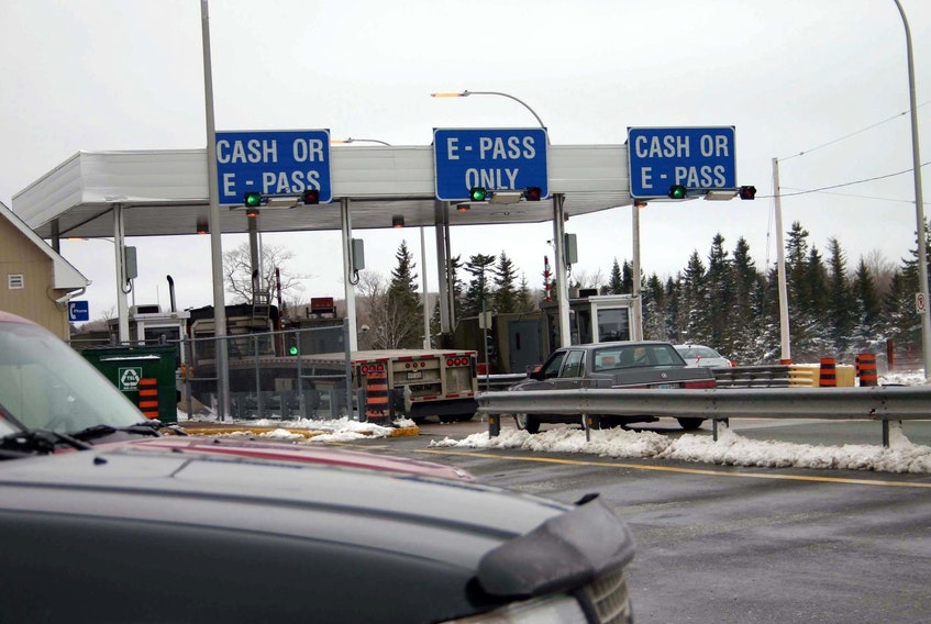 Traffic passes through the Cobequid Pass toll booths. - Herald file
