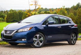 With four doors and a flexible cargo hold, the Leaf might be an ideal second-car for your family (2019 Leaf shown here). - Nissan