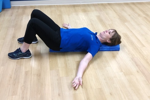 Laura Lundquist demonstrates a low-load, prolonged stretch.