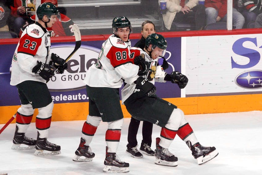 Halifax Mooseheads captain Antoine Morand and athletic therapist Robin Hunter carry defenceman Jared McIsaac off the ice after taking a check in a January 13 game at the Scotiabank Centre. (ERIC WYNNE/Chronicle Herald)