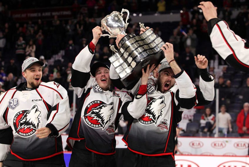 Rouyn-Noranda Huskies captain Rafael Harvey-Pinard, centre, raises the Memorial Cup with his teammates at the Scotiabank Centre on May 26. - Eric Wynne