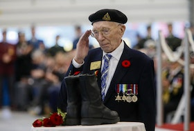 Henry Ardwell Francis Eyres salutes after laying a rose during the Boots of Remembrance portion of the 75th anniversary of D-Day ceremonies at Willow Park Armoury in Halifax on Thursday, June 6, 2019. - Tim Krochak