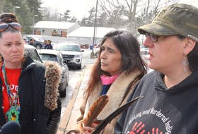 Michelle Paul, left, Darlene Gilbert and Madonna Bernard stand outside the RCMP detachment in Enfield on Wednesday afternoon. Gilbert and Bernard were arrested in the morning at the Alton Gas work site next to Shubenacadie River but were released without being charged.