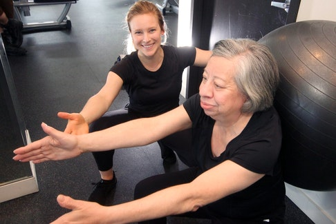 Leanne Wiese (left), who owns and operates Wiese Moves, trains Nancy Briand in the gym at the Maple on Hollis Street in Halifax.
