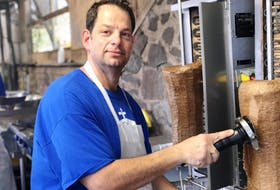 Michael Nicoletopoulos makes sure the donair is as fresh as it should be for guests of the annual Halifax Greek Fest. - Maan Alhmidi