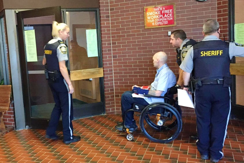 Leif Spilchen is wheeled into Kentville provincial court on Oct 4, 2017.