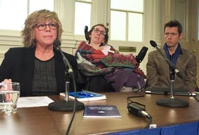 Barb Horner of the Disability Rights Coalition of Nova Scotia, Jen Powley of No More Warehousing and her care worker John Whittington, speak to MLAs on housing challenges in Nova Scotia for the disabled. A judge ruled Thursday that national groups can intervene in a legal fight over community care for the disabled. - File