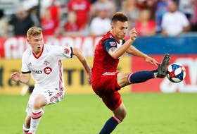 FC Dallas defender Bressan (4) controls the ball as Toronto FC midfielder Jacob Shaffelburg (24) defends during the second half of an MLS game on Saturday at Toyota Stadium in Frisco, Tex. - Kevin Jairaj/USA TODAY Sports