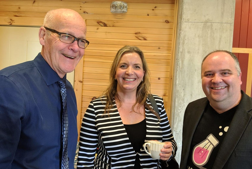 Kings County Warden Peter Muttart, Rachel Brown of the Atlantic Canada Opportunities Agency and entrepreneurial support businessman Andrew Button chat after a federal plan to expand high-speed internet access was unveiled at Ross Farm Museum in New Ross on Thursday.