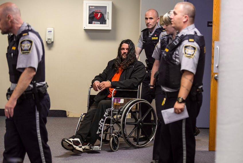 Ontario Hells Angels member Mark David Heickert is wheeled out of Dartmouth provincial court in November 2017 after his arraignment on drug conspiracy charges. – Ryan Taplin