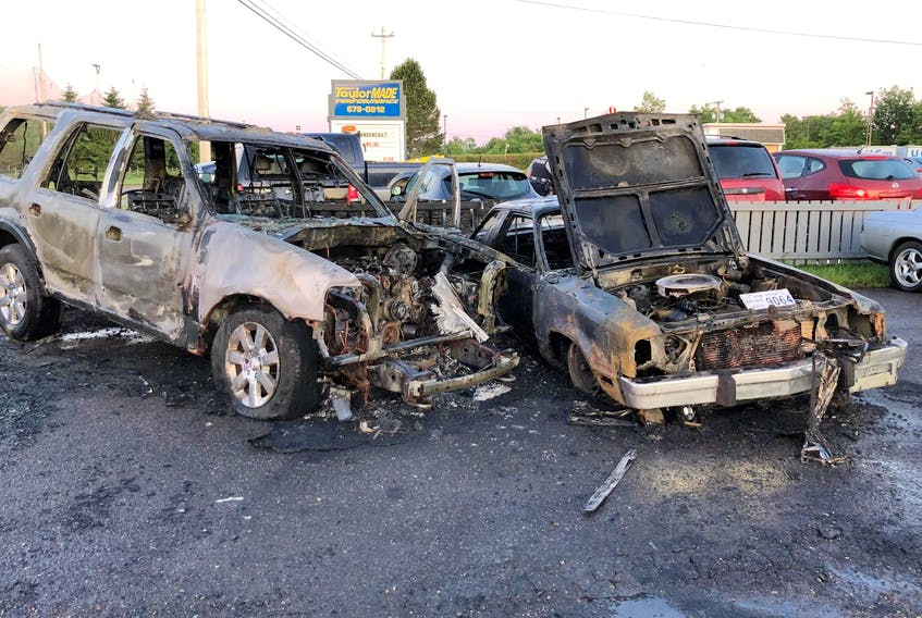 Two cars were destroyed in a fire at a car service business in Coldbrook, Kings County, early Thursday morning, July 11, 2019. - Herald staff