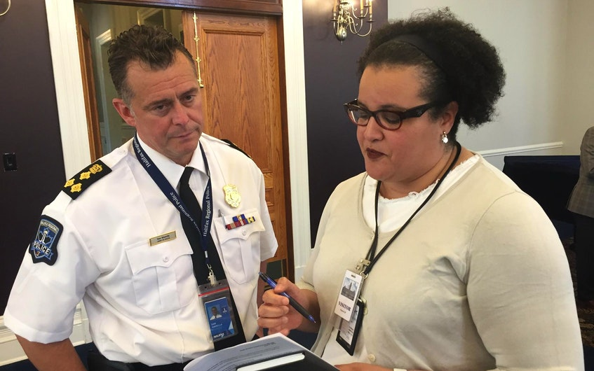 Halifax Police Chief Dan Kinsella and Natalie Borden, a member of the Halifax police commission, confer at a commission meeting at city hall in this file photo. - Francis Campbell