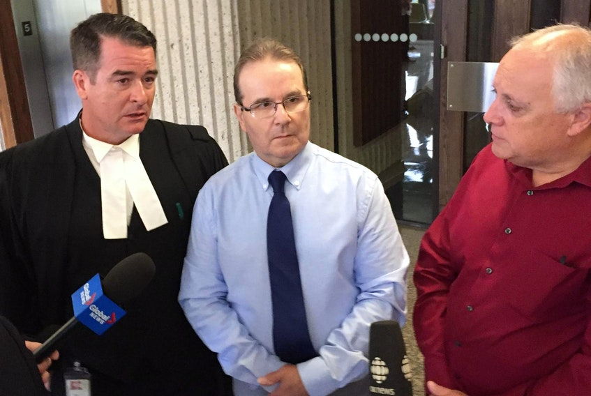 Glen Assoun, centre, is shown with his lawyer Sean MacDonald, left, and Ron Dalton, co-founder of Innocence Canada.
