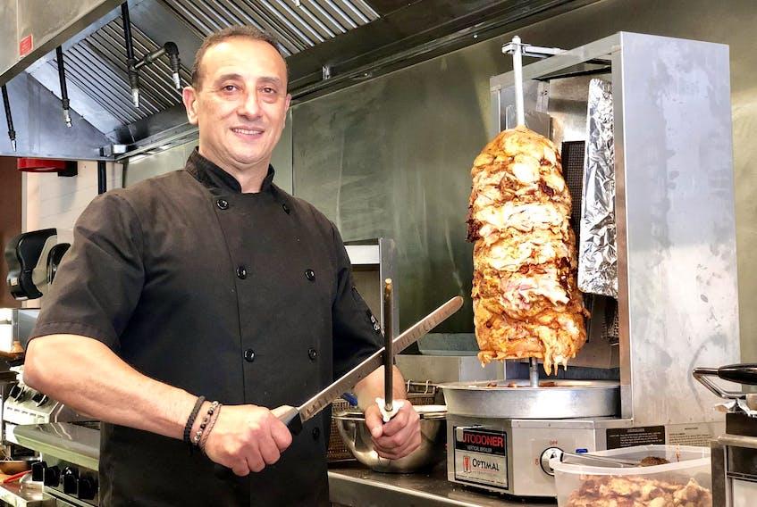 Roy Khoury has made shawarma for three decades. - Maan Alhmidi