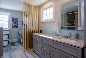 The lack of functional storage in this bathroom was another driving force behind the renovation. - AMacPhotography