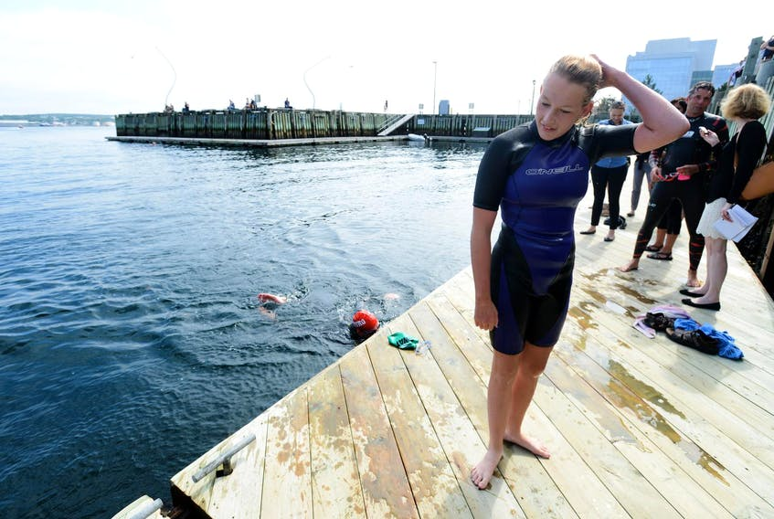 Anny Christian, from Lower Sackville stands on the dock after completing a swim from the Woodside Ferry terminal in Dartmouth to Bishoph's Landing in Halifax in 2015. - File