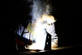 A worker at Cherubini Metal Works Ltd. uses an arc welder on a job on the shop floor of the company's Burnside location. - Eric Wynne