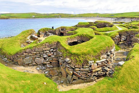 Ancient ruins on Scotland's Orkney Islands include these 5,000-year-old homes at Skara Brae. - Cameron Hewitt