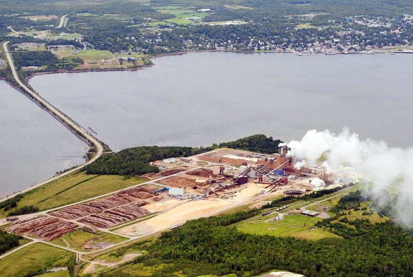 The Northern Pulp mill is seen in Abercrombie Point in 2014, with the Town of Pictou in the background. FILE