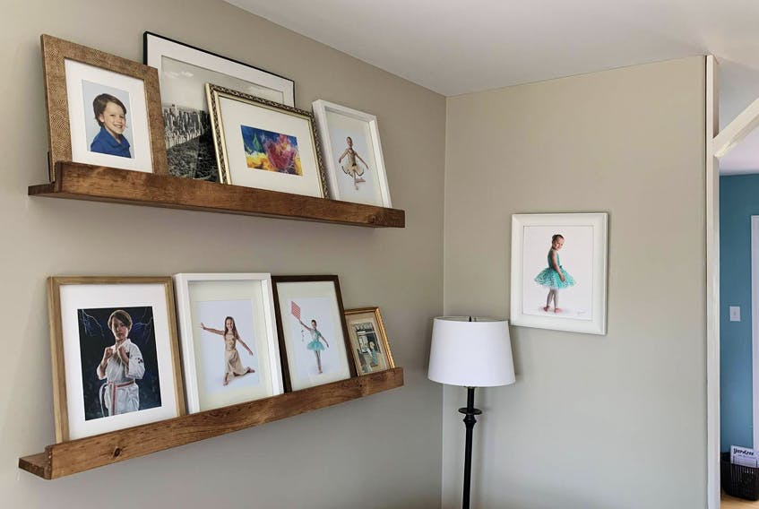 Heather loves her new, wider photo ledges — and so far, the frames are staying put! - Heather Laura Clarke