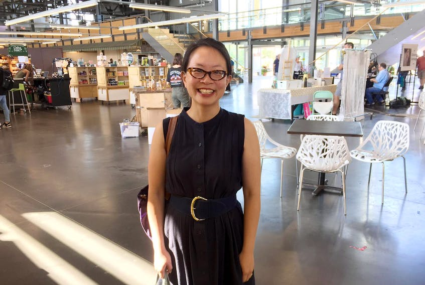 Dr. Catherine L. Mah, holder of the Canada Research Chair in Promoting Healthy Populations at Dalhousie University, visits the Halifax Seaport Farmers' Market. - Tim Arsenault