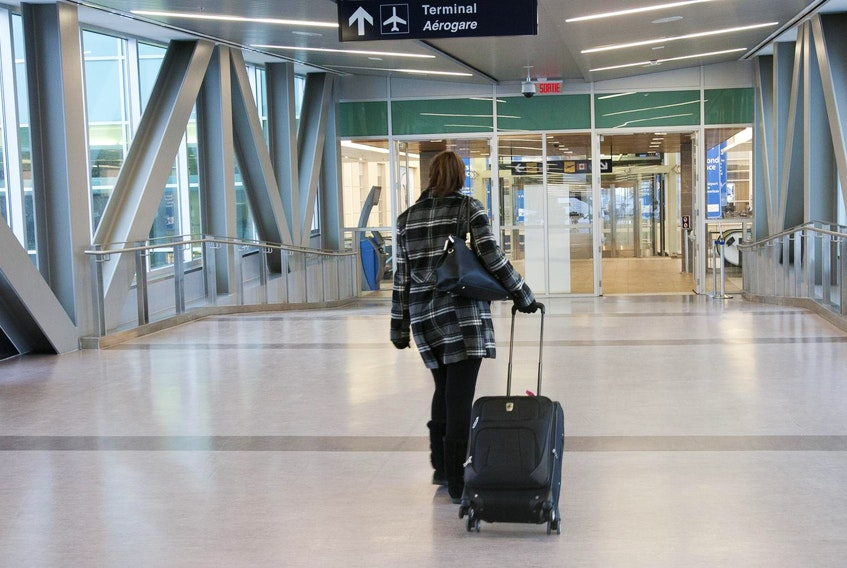 A passenger makes her way into the terminal at Halifax's Stanfield airport.