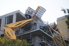 A crane collapsed onto a building on Brenton Place and Brenton Street on Saturday during hurricane Dorian. - Ryan Taplin