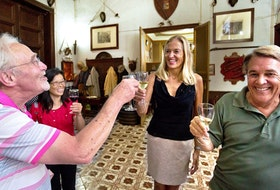 Countess Alwine Federico toasts tour group members in her home, Palazzo Conte Federico — one of the oldest dwellings in Palermo, Sicily. - Dominic Arizona Bonuccelli