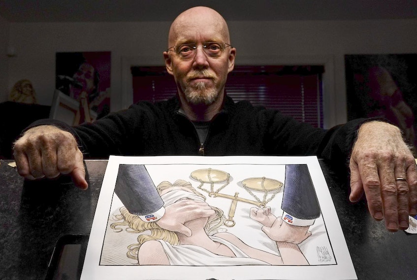 Halifax Chronicle Herald editorial cartoonist, Bruce MacKinnon, is seen with his cartoon, Lady Justice, in his workspace in Halifax.