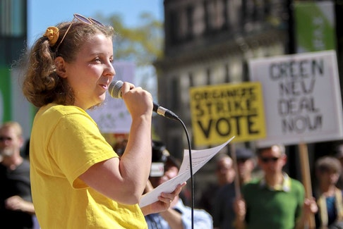 Willa Fisher, teenage climate change activist, speaks to a gathering at a rally against climate change in the Grand Parade in Halifax Friday. TIM KROCHAK / The Chronicle Herald