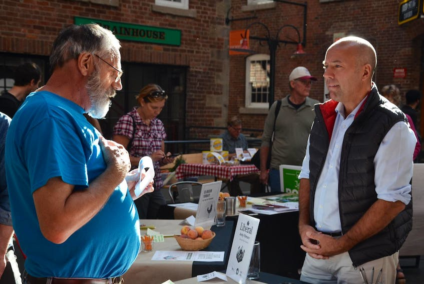Blake Harris, left, chats with Liberal candidate Andy Fillmore at the Eat Think Vote event at the Halifax Brewery Market in Halifax on Saturday morning. Halifax Citadel-Sable Island federal election candidates Fillmore and Jo-ann Roberts of the Green Party spoke with people at the market about food security and agriculture. NICOLE MUNRO