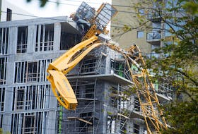 The crane that fell during hurricane Dorian on Sept. 7 still remains on top of building under construction as of Monday afternoon. Ryan Taplin - The Chronicle Herald