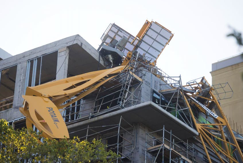 The province has hired two companies to remove a crane that collapsed at a Halifax construction site during hurricane Dorian. - File