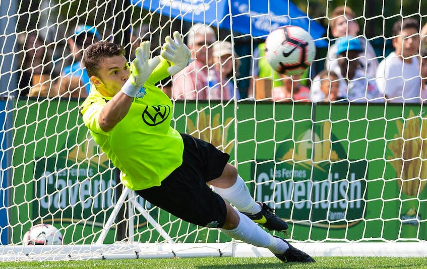 HFX Wanderers goalie Christian Oxner makes a save on a penalty kick by Cavalry Fc's Dominique Malonga during a CPL game on on Aug. 10th, 2019 at the Wanderers Grounds. - Trevor  MacMillan