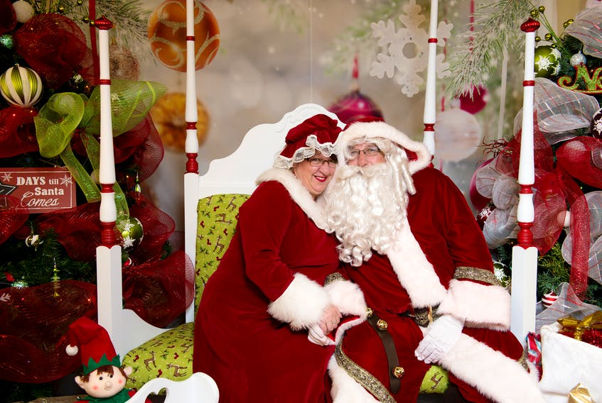 Paul and Jacquie Sinclair in their own costumes as Santa and Mrs. Claus.  Their earnings from the photoshoot are donated to the Children's Wish Foundation.